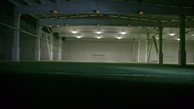 vídeos y material grabado en eventos de stock de turning off lights in empty indoor soccer field - turning on or off