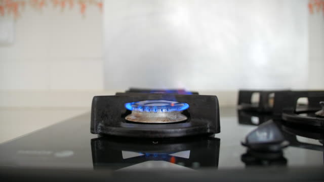 turning on a natural gas stove - knob stock videos & royalty-free footage