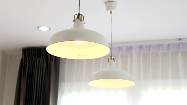 turning on and off bulbs light. - electric lamp stock videos & royalty-free footage