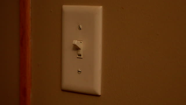 turning on and off light switch - turning on or off stock videos & royalty-free footage