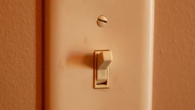 turning on and off light switch - light switch stock videos & royalty-free footage