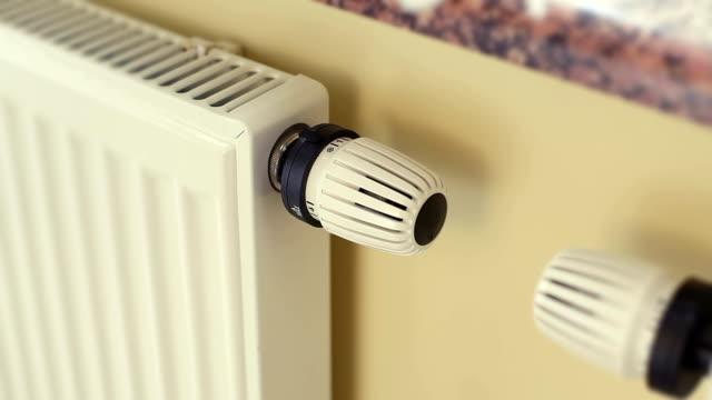 stockvideo's en b-roll-footage met turning on the radiator - turning on or off