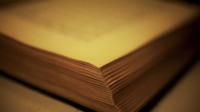 turning pages of an old book - hardcover book stock videos and b-roll footage