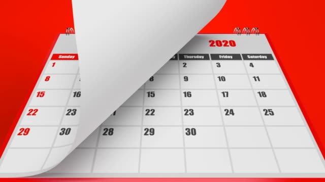 turning pages of calendar 2020 year on red background - calendar stock videos & royalty-free footage