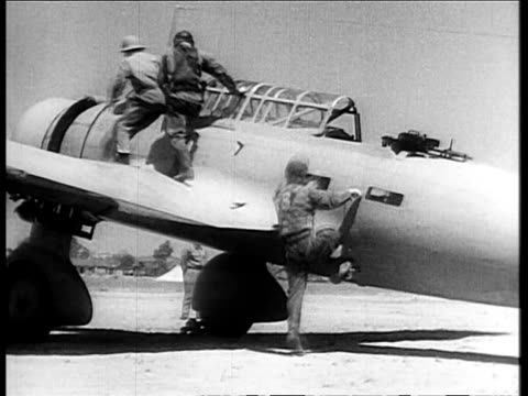 turning propellers of bombers on airfield / japanese military pilots listening to orders outdoors / pilots saluting / pilots boarding bomber / groups... - 1932 stock videos & royalty-free footage