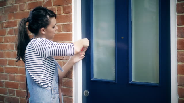 turning the key, opening the front door. - ponytail stock videos & royalty-free footage