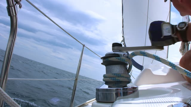 hd: turning the sail winch on a boat - sailing boat stock videos and b-roll footage