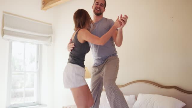 stockvideo's en b-roll-footage met hun bed veranderen in een dansvloer - bed