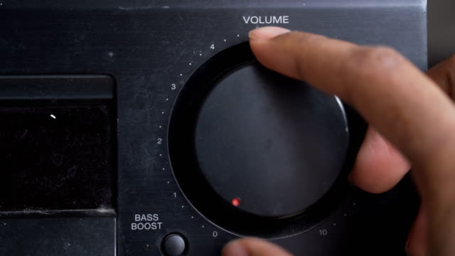 vídeos de stock e filmes b-roll de turning up the volume by right human hand - barulho