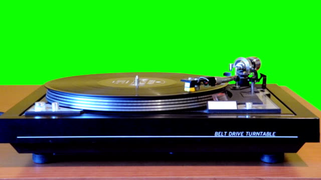 turntable playing vinyl with chroma background - record player stock videos & royalty-free footage
