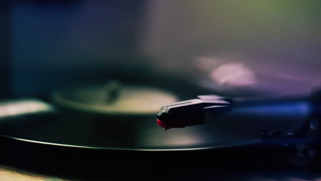 turntable, stylus and record. low angle selective focus. - rocking stock videos & royalty-free footage
