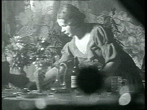 stockvideo's en b-roll-footage met turntable with spinning record, woman setting table at home, man looking at calendar / moscow, russia - 1935
