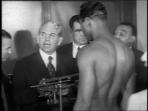 vídeos de stock, filmes e b-roll de turpin smiling at his own weigh-in / fighters shaking hands - 1951
