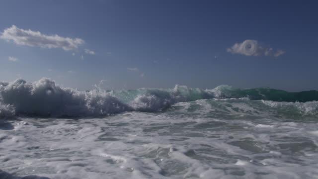 turquoise breaker splashes over camera, bahamas - bimini stock videos & royalty-free footage