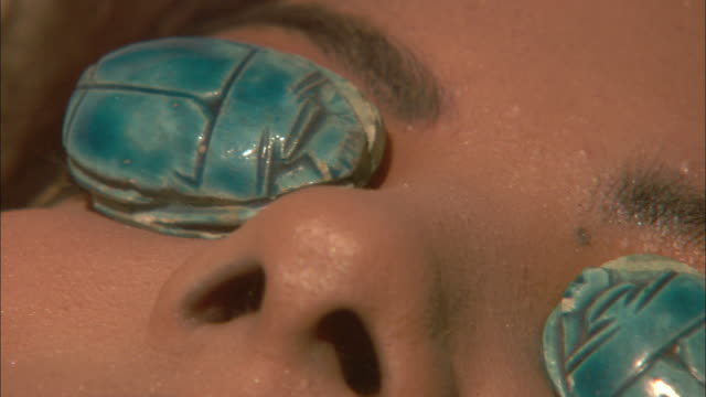 turquoise scarabs close the eyes of cleopatra. - cleopatra stock videos & royalty-free footage