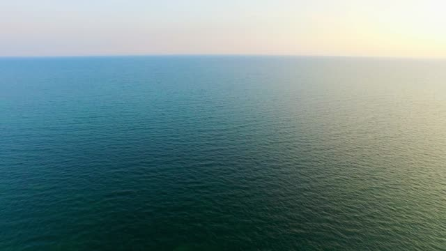 aerial: turquoise sea in sunrise - water surface stock videos & royalty-free footage