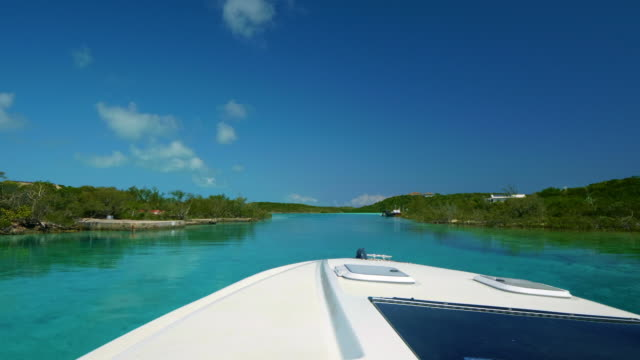 turquoise water and island seen from motorboat - motorboat stock videos & royalty-free footage