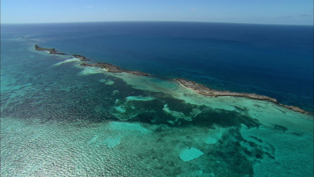 aerial turquoise water near bimini, bahamas - bahamas stock videos and b-roll footage