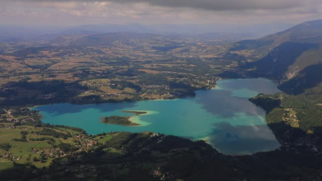 """turquoise waters of the alpin lake """"lac d aiguebelette"""" pictured from the """"mont grele"""" mountain on september 3, 2020 in saint thibault de couz,... - nature reserve stock videos & royalty-free footage"""