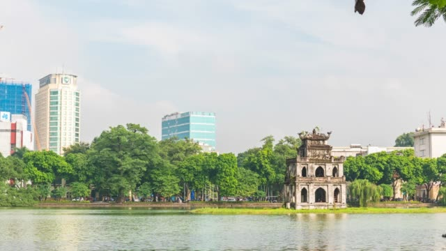 turtle tower on hoan kiem lake and blue sky, hanoi, vietnam, time lapse video - hanoi stock videos and b-roll footage