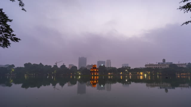 turtle tower on hoan kiem lake with fog in the morniing, hanoi, vietnam, time lapse video - traditionally vietnamese stock videos & royalty-free footage