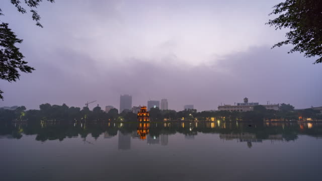 turtle tower on hoan kiem lake with fog in the morning, hanoi, vietnam, night to day time lapse video - hanoi stock videos and b-roll footage