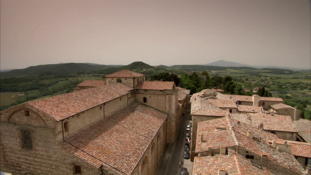 a tuscan village is seen from a rooftop in montepulciano, tuscany. available in hd. - montepulciano stock videos & royalty-free footage