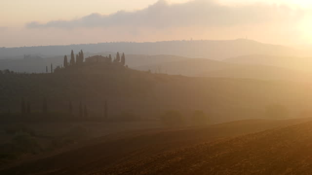 Tuscany landscape at sunrise, Italy.