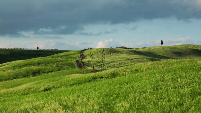 tuscany, panning shot of a series of green hills. - tuscany stock videos & royalty-free footage