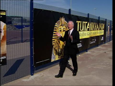 tutankhamun exhibition at the o2 arena; ext reporter to camera - exhibition stock videos & royalty-free footage