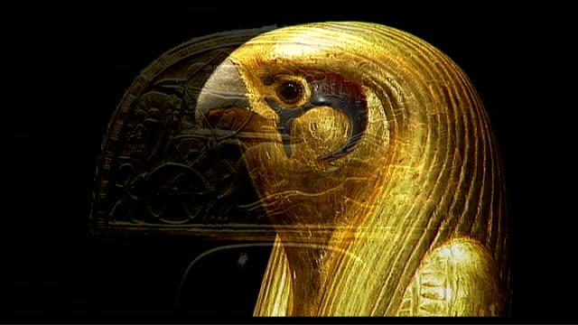 tutankhamun exhibition at the o2 centre 02 centre int close shots of gold face mask of tutankhamun head of golden bird golden artefact depicting... - dagger stock videos & royalty-free footage