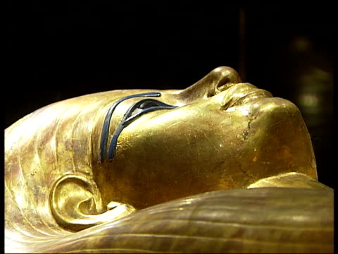 tutankhamun exhibition at the o2 centre god with the head of a lionness / statue with wings instead of arms / highly decorated sarcophagus / jars... - pharaoh stock videos & royalty-free footage