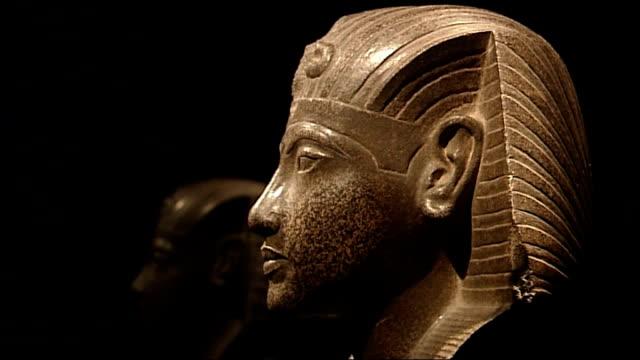 tutankhamun exhibition at the o2 england london the o2 int statue of king tutankhamun on display at ' tutankhamun and the golden age of the pharoahs'... - pharaoh stock videos & royalty-free footage