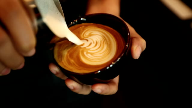 tutorial barista making art latte, slow motion - froth art stock videos and b-roll footage