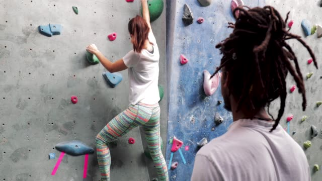 tutoring a climbing lesson - climbing wall stock videos & royalty-free footage
