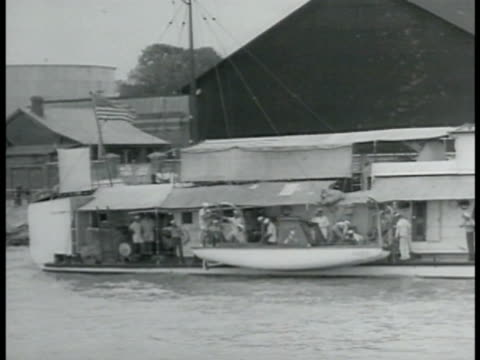 tutuila ferry docked at pier ws lowering gunboat into river ha ws us sailors on deck at tables ws ferry in harbor sailboat fg second sinojapanese war... - 1937 stock videos and b-roll footage