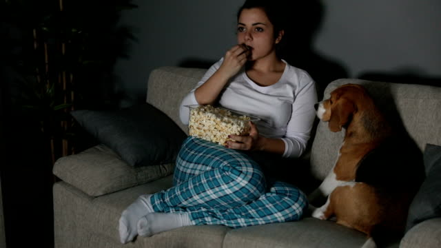 tv and popcorn - pyjamas stock videos and b-roll footage