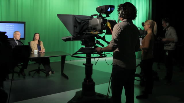 Tv presenters and crew in television studio