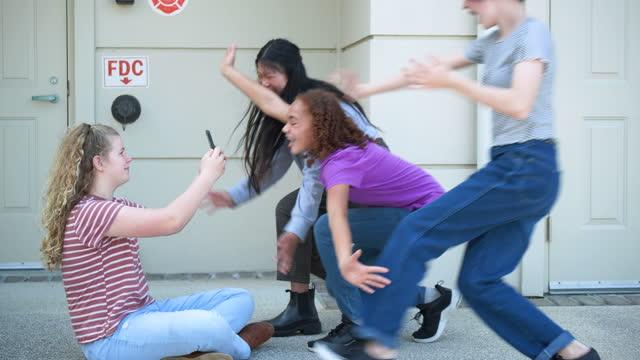tween girl filming friends with smart phone - 12 13 years stock videos & royalty-free footage