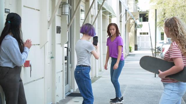 tween girls on sidewalk, make video of one skateboarding - 12 13 years stock videos & royalty-free footage