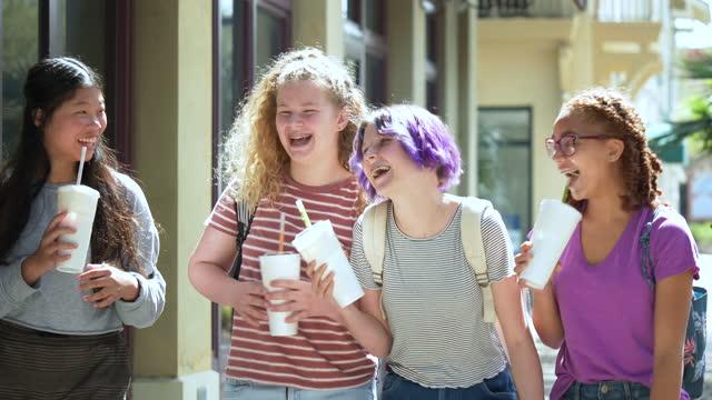 tween girls walk, talk on sidewalk, drinking, laughing - 12 13 years stock videos & royalty-free footage