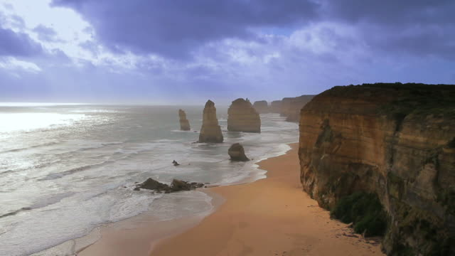WS SLO MO Twelve Apostles battered by waves and stormy clouds billowing / Port Campbell, Victoria, Australia