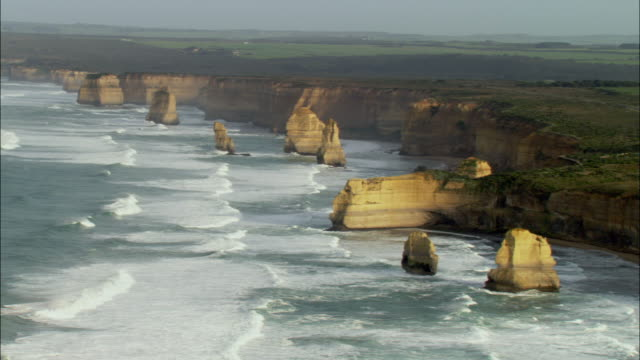 ws zo aerial twelve apostles rock formations, melbourne, victoria, australia - limestone stock videos and b-roll footage