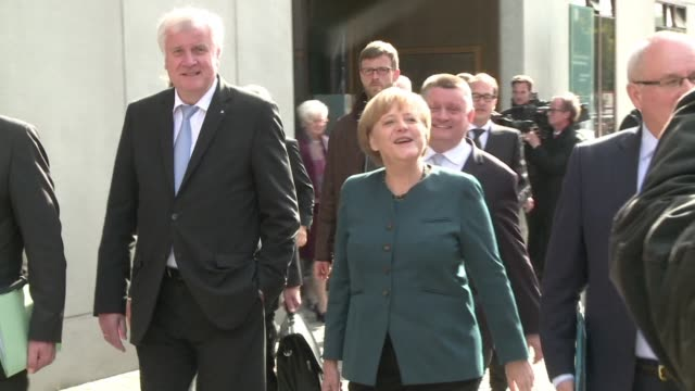 twelve days after german elections chancellor angela merkel started exploratory talks friday with her defeated centreleft rivals on whether they can... - possible stock videos & royalty-free footage
