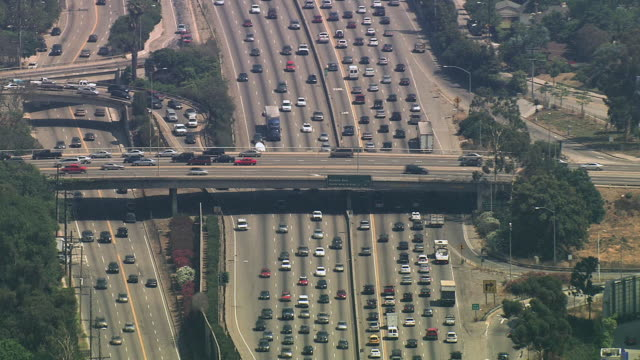 AERIAL Twelve lane expressway full of rush hour traffic / California, United States
