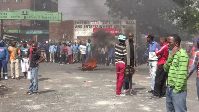 twelve people were arrested overnight as anti-foreigner attacks in south africa spread to parts of downtown johannesburg, police said friday - friday stock videos & royalty-free footage