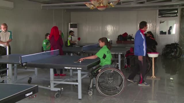 twelve year old iraqi nejla imad holds a white table tennis ball against her bat with her thumb flicks it into the air and sends it bouncing over the... - table tennis bat stock videos & royalty-free footage