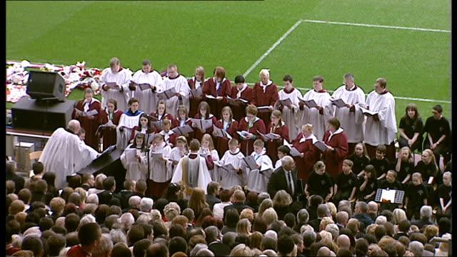 twentieth anniversary of hillsborough disaster: memorial service; choir singing, trevor hicks addressing crowd / james jones conducting service /... - anniversary stock videos & royalty-free footage