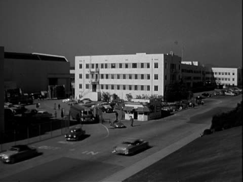 Twentieth Century Fox studios cars buses and trucks exit and enter through gated main entrance Twentieth Century Fox Studios on January 01 1951 in...