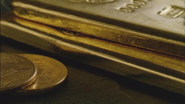ecu, pan, twenty dollar gold coins and three gold ingots - ingot stock videos and b-roll footage